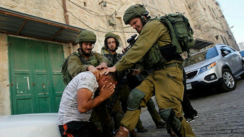 israil-askerleri-filistinli